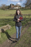 Young female vicar walking in her parish Stock Images