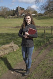 Young female vicar walking in her parish Royalty Free Stock Photography