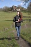 Young female vicar walking in her parish Stock Image