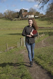 Young female vicar walking in her parish Royalty Free Stock Images