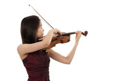 Young female violin player. Young asian woman playng the violin on white background Royalty Free Stock Photography