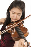 Young female violin player. Young asian woman playng the violin on white background Royalty Free Stock Image