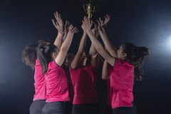 Young Female volleyball team celebrating victory in game royalty free stock photos