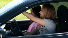Young female waiting her friend in the car stock footage