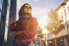 Young female walking by the shopping street Stock Images