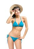 Young female wearing bikini, hat and sunglasses Royalty Free Stock Photo