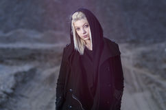 Young female wearing black hood. In nature night shot Royalty Free Stock Photography