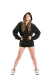 Young female wearing a black hoodie and shoes. Young and sexy female wearing a black hoodie and shoes. Full body standing isolated on white background Stock Images