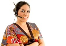 Young female wearing kimono with headset Stock Photos