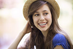 Young female wearing straw hat Stock Photography