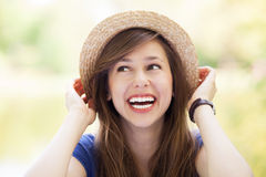 Young female wearing straw hat Stock Photo