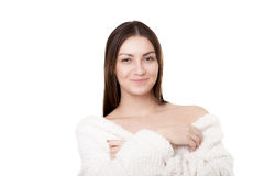 Young female in white bathrobe smiling Stock Photography