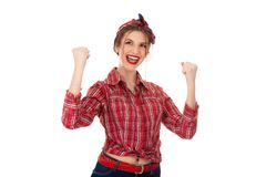 Young female winner raising arms, clenching fists, exclaiming with joy and excitement stock image