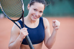 Young female winning a tennis match Stock Photos