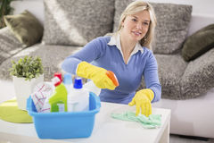 Young female wiping table Stock Images