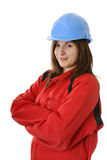 Young female worker with blue helmet Royalty Free Stock Images