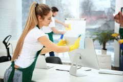 Young female worker cleaning office Royalty Free Stock Image