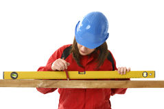 Young female worker with level Royalty Free Stock Photo