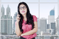 Young female worker standing near the window Royalty Free Stock Images