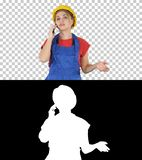 Young female worker talking on phone while walking, Alpha Channel stock photo
