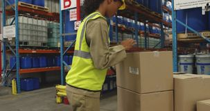 Young female worker using barcode scanner in a warehouse stock video