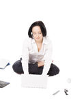 Young female worker using laptop in lotus pose on white backgrou Stock Photo
