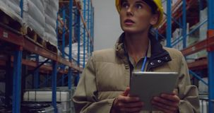 Young female worker in a warehouse stock footage