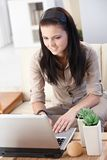 Young female working at home Royalty Free Stock Photos