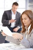 Young female working with papers in office royalty free stock photo
