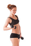 Young female workout with dumbbells Stock Images