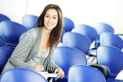 Young female is writing notes Royalty Free Stock Photos