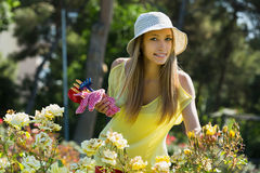 Young female in yard gardening Royalty Free Stock Images