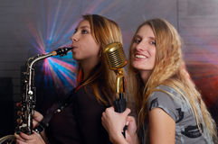Young females with microphone Stock Photos