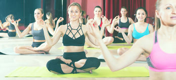 Young females practice yoga stock photography