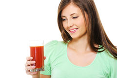 Young femlae with a glass of tomato juice Royalty Free Stock Photo