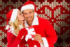 Composite image of young festive couple royalty free stock image