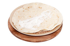 Young feta cheese spread on Mexican tortilla Royalty Free Stock Photo
