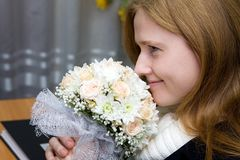 A young fiancee with a wedding bouquet Royalty Free Stock Photography