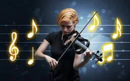 Young fiddler with music sheet stock photos