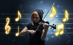 Young fiddler with music sheet stock photo