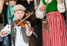 Young fiddler at a Swedish folk music festival. Bingsjo, Sweden – July 3, 2013: Annually on the first Wednesday in July Sweden's most famous traditional folk Royalty Free Stock Photos