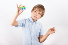Young fidget spinner magician playing with three fidget spinners Royalty Free Stock Image