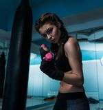 Young fighter boxer girl with hand bandage in training with dumb Royalty Free Stock Images
