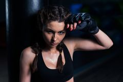 Young fighter boxer girl tired after training Royalty Free Stock Images