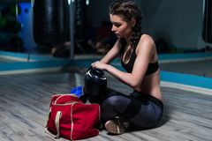 Young fighter boxer girl wearing boxing gloves before  training Royalty Free Stock Photos