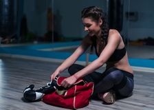 Young fighter boxer girl wearing boxing gloves before training royalty free stock images
