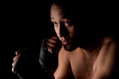 Young fighter holding guard Royalty Free Stock Photography