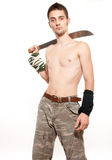 Young fighter holding a machete Royalty Free Stock Photography