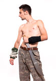 Young fighter holding a machete Royalty Free Stock Photo