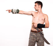 Young fighter holding a machete Stock Image